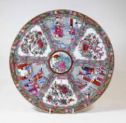 A 20th century Chinese Canton porcelain charger, decorated with flora, fauna and figures in an