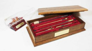 A box containing a collection of various items, to include a cast metal model of Napoleon Bonaparte,