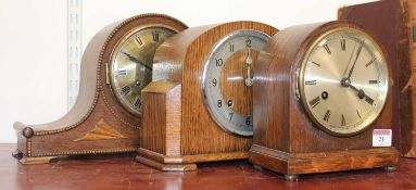 A 1930s oak cased eight day mantel clock, h.20cm; together with another 1930s oak mantel clock by