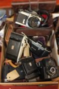 A box containing a collection of early 20th century cameras, to include a Zeiss Ikon, an Ensign