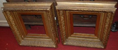A pair of late 19th century giltwood and composition picture frames, each with beaded and acanthus