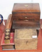 A 1920s walnut work box, having a hinged lid opening to reveal partitioned interior, above a
