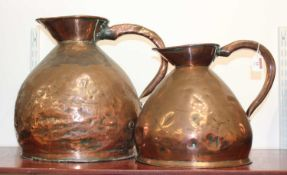 A large 19th century copper flagon, h.37cm; together with one other smaller example (2)