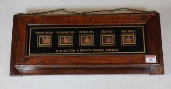 A circa 1900 mahogany butlers/servants bell-box, of rectangular form, marked HW Sutton, 2 Station