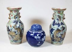 A pair of stoneware vases, each of baluster form, enamel decorated with various birds, butterflies