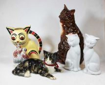 A collection of assorted cat ornaments, to include Staffordshire and Winstanley examples; together