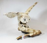 A large William Lawrence ceramic model of an owl, having outstretched wings and perched on a branch,