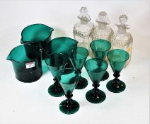 A set of three 19th century cut glass decanters and stoppers; together with a set of six green
