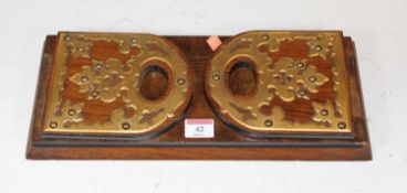 A Victorian walnut and brass mounted sliding book trough