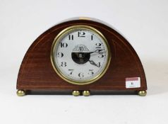 An early 20th century French mahogany and boxwood strung cased Electrique mantel clock, the convex
