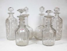 A near-pair of Regency cut glass triple ring neck decanters with mushroom stoppers (one stopper