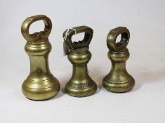 A set of three early 20th century brass bell weightsCondition report: Weights – 3.5kg, 1810.8g,
