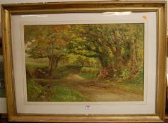 Cyril Ward - Shepherd resting on a wooded lane, watercolour, signed lower left, 50x75cm