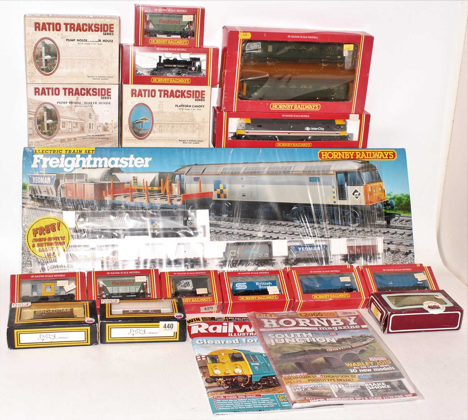 A Hornby Railways and similar 00 gauge boxed locomotive rolling stock accessory group to include a
