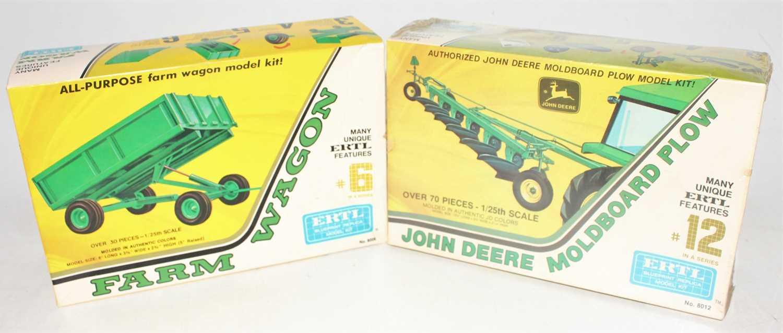 A group of two boxed Ertl farm kits as follows: John Deere Moldboard plow (still sealed) and a