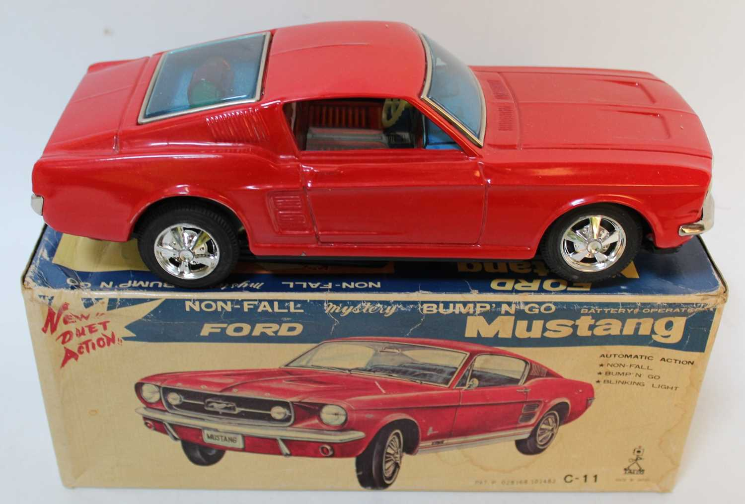 Taiyo Tinplate battery powered Ford Mustang (red) tiny rub mark to roof, very near mint in box. ( - Image 2 of 3
