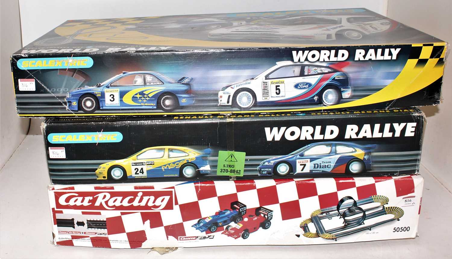 Three various boxed Carerra and Scalextric boxed slot car racing gift sets to include a Carerra