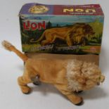 A Marx Toys mechanical, mohair and clockwork model of a growling lion housed in the original card