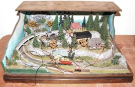 A very well made Marklin Z Gauge housed in a wooden case with skyline back drop, built to a very