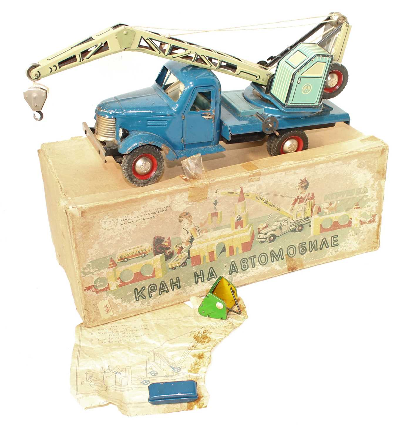 A Hungarian tinplate and clockwork model of a four wheel crane, finished in dark blue with two-