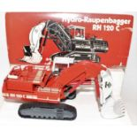 A Conrad No. 2771 1/50 scale boxed model of an O&K RH 120C crawler excavator, finished in O&K livery