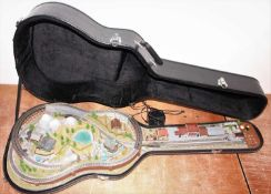 A very well made Marklin Z Gauge Layout, housed in a guitar case, built to a very high standard, for
