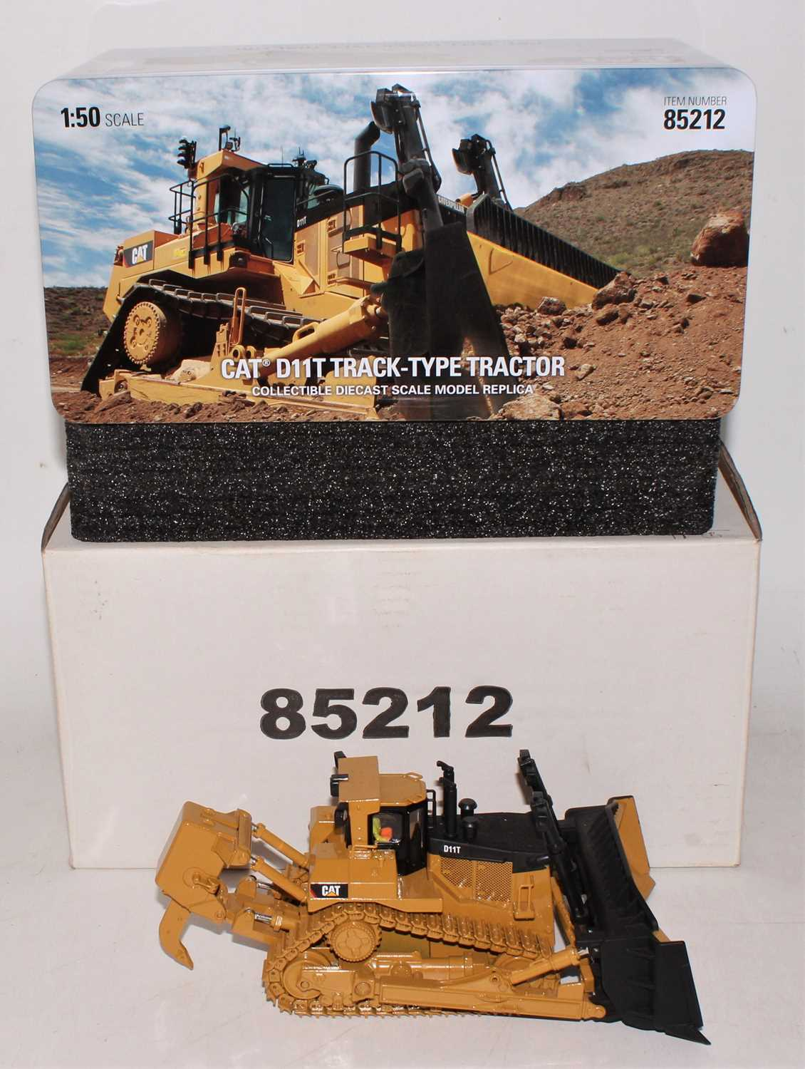 A diecast Masters Real Replicas Highline series model No.85212 1/50 scale model of a Caterpillar
