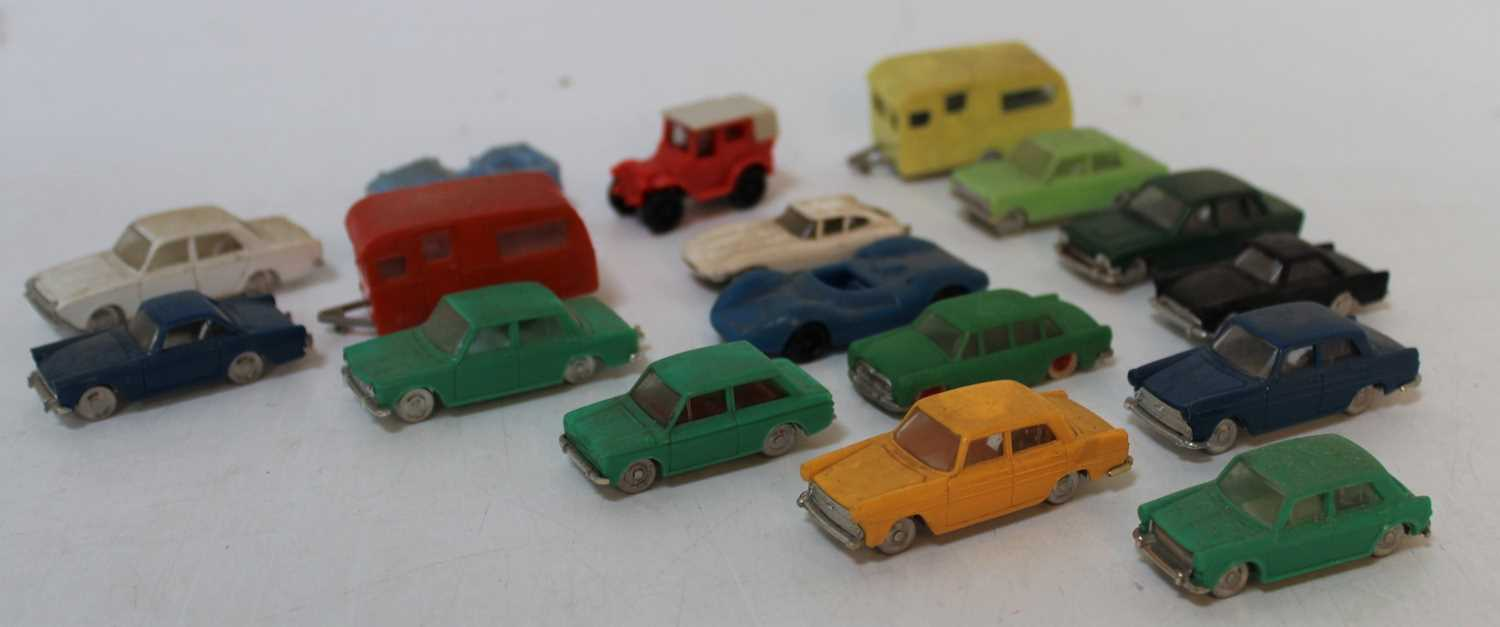 A collection of Minix and Hong Kong issue plastic vehicles and attachments to include a Minix No.