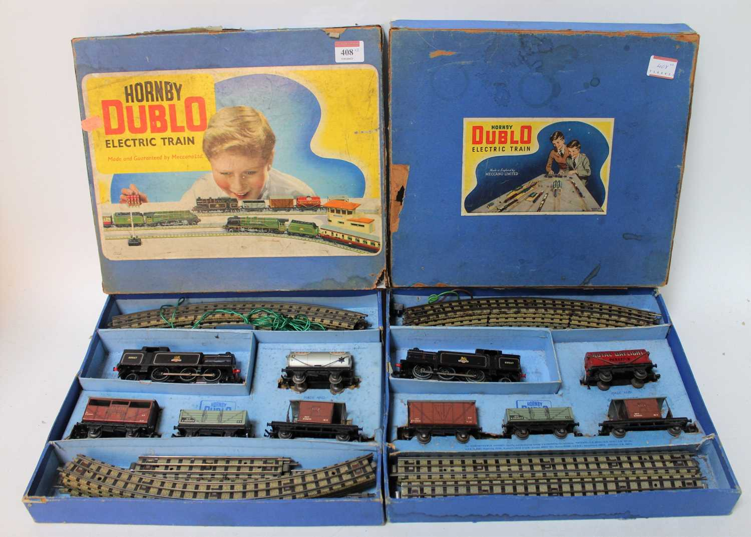 Two Hornby Dublo EDG17 0-6-2 tank goods sets. One with gloss loco 69567 other same number matt