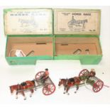A Britains Home Farm series No. 8F horse rake group, two example, one finished in green, the other