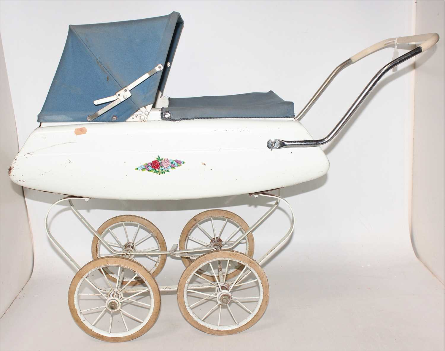 Triang dolls pram, circa mid 1960s in good condition for age, complete with original cover and hood.