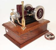 A very well engineered model of a 4 Stroke Single Cylinder Petrol Engine, finished in maroon and