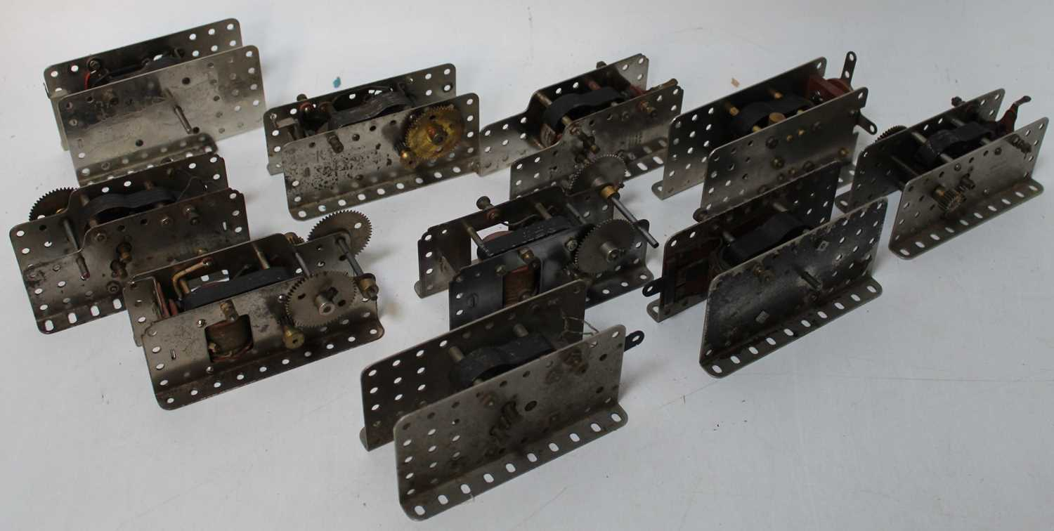 Ten Meccano electric motors, nickel side plates, side levers, sway backs