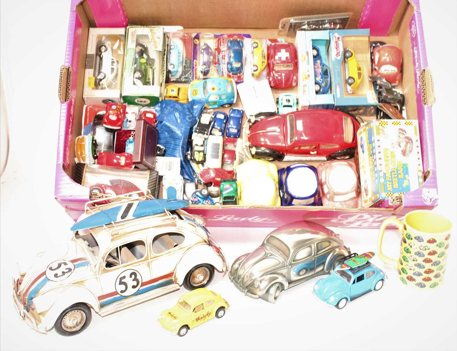 One tray containing a quantity of various VW related tin plated diecast and related effects, to