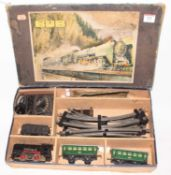 Karl Bub electric train set comprising 0-4-0 loco and tender (black with red wheels and valance),