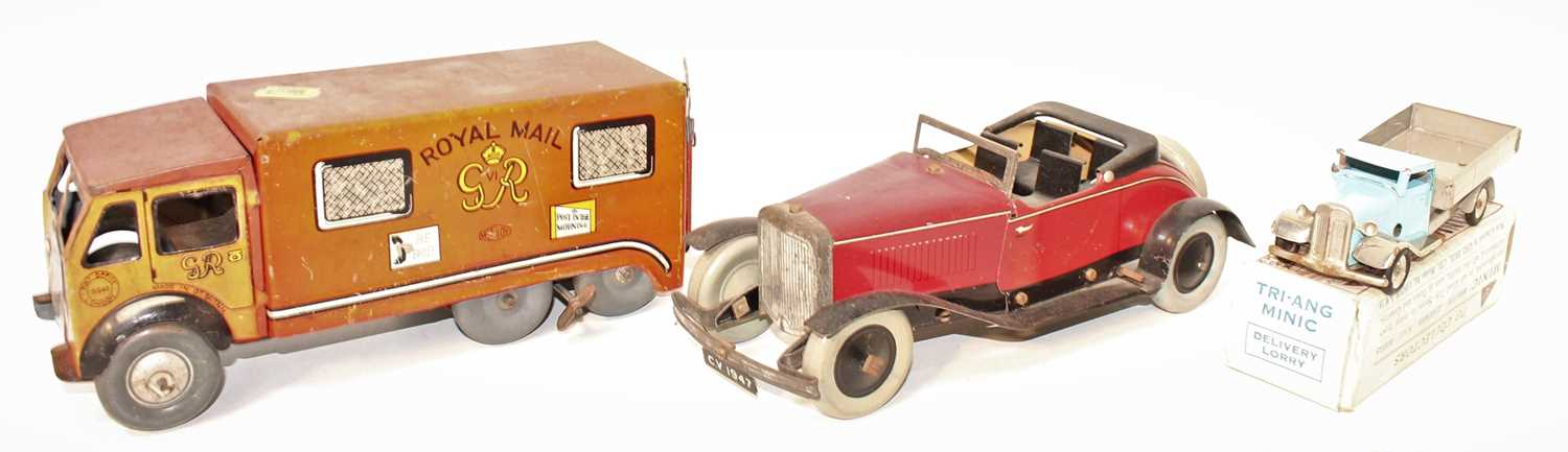 A collection of tinplate mixed commercial and saloons to include a Mettoy No. 15546 Royal Mail