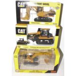A Norscot and ERTL 1/50 scale Caterpillar diecast group to include an ERTL Caterpillar 5080 front