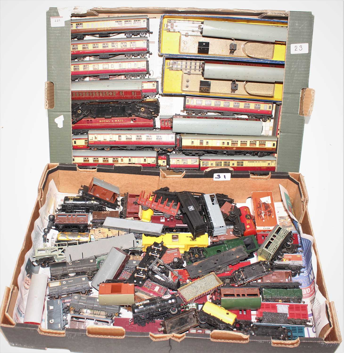 Two trays containing a quantity of various Hornby Dublo and 00 scale rolling stock and
