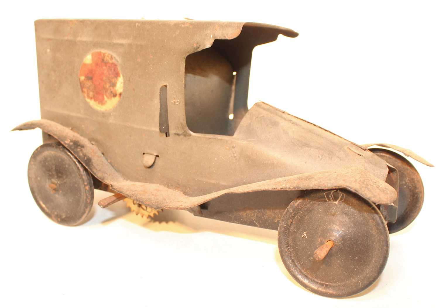 An early 20th century tinplate and clockwork model of a military ambulance finished in grey with