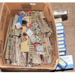 Large box containing wide variety pieces of Hornby Dublo 3-Rail Track, including manual points and
