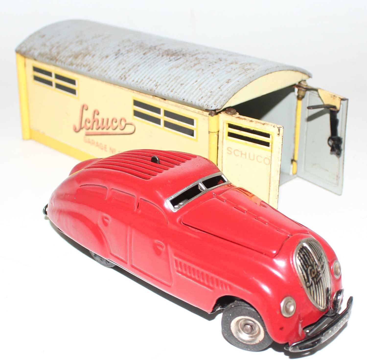 "A Schuco vintage tinplate clockwork car in a garage ""Kommando Anno 2000"" circa mid 40s complete with - Image 3 of 4"