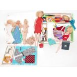 """A """"The World of Barbie"""" by Mattell doll case, containing a quantity of various Barbie dolls,"""