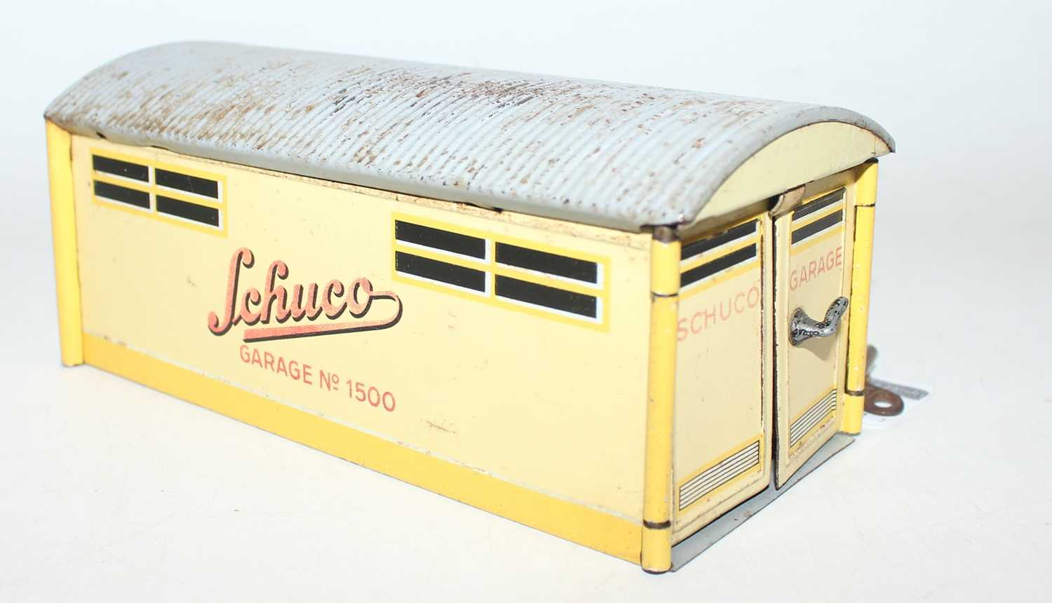 "A Schuco vintage tinplate clockwork car in a garage ""Kommando Anno 2000"" circa mid 40s complete with - Image 2 of 4"