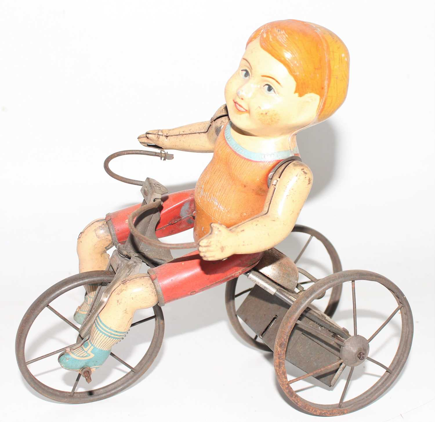 A Marx tinplate and clockwork model of a Wonder Cyclist comprising of Three wheeled trike fitted