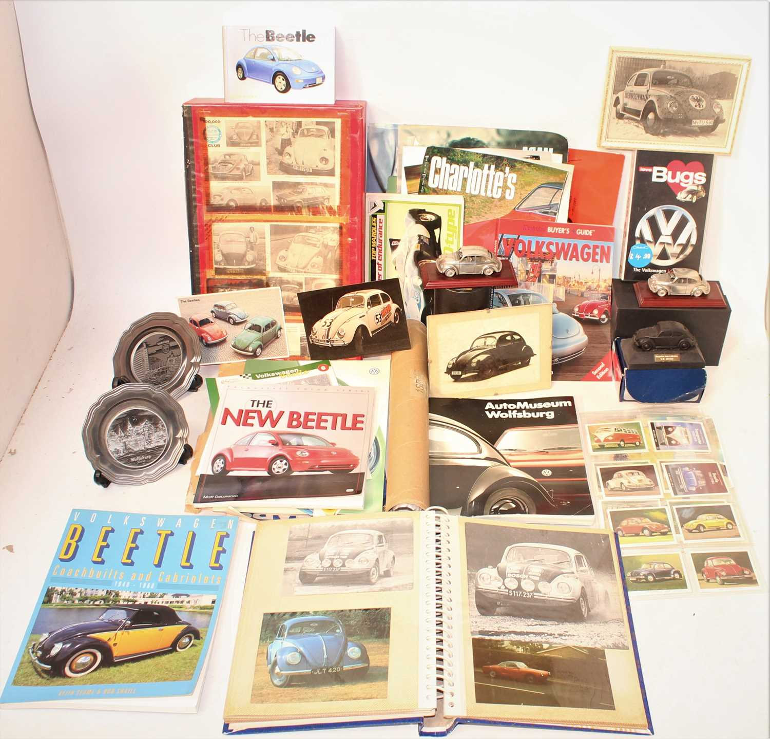 Two boxes containing a quantity of various VW related ephemera, trade catalogues, figurines, press