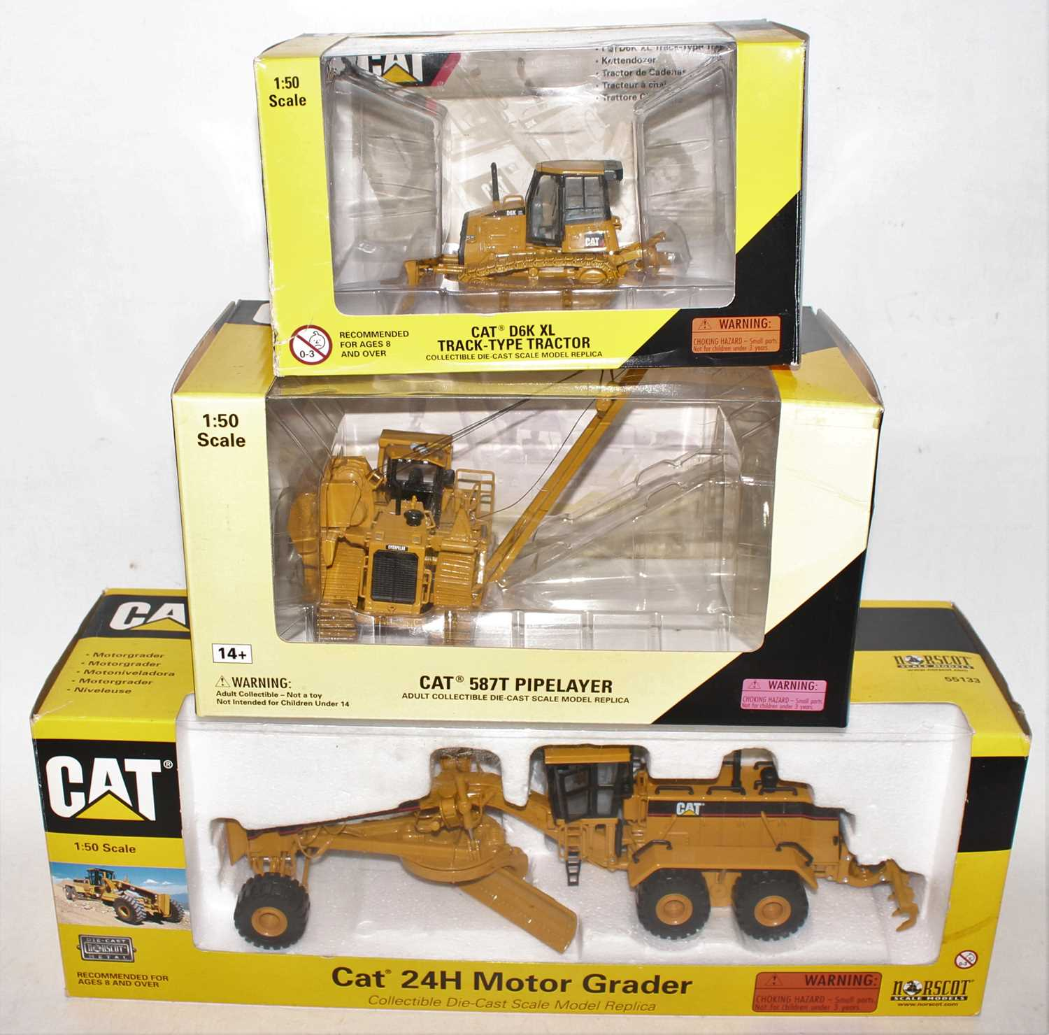 A Norscot 1/50 scale Caterpillar boxed diecast group, three examples to include a Caterpillar D6K XL