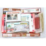 A box of lineside kits in plastic and card, including Fleischmann 3-Bay Engine Shed, Faller