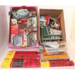 Three boxes containing a large quantity of various 00 gauge and H0 scale lineside accessories track,