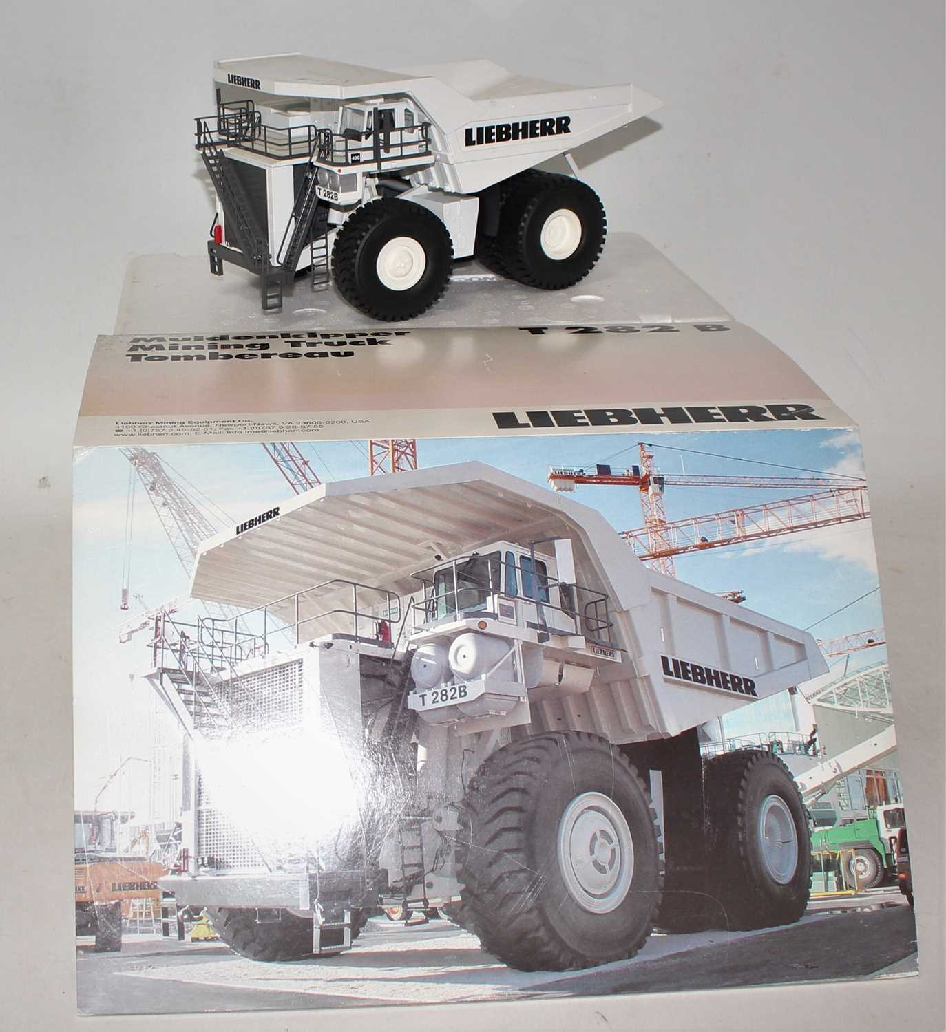 A Conrad Model No. 2727/0 1/50 scale diecast model of a Liebherr T282B mining truck, finished in