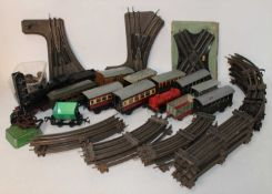 Plastic crate containing non-Hornby (? possibly JEP) tinplate electric 3-rail track (in need of